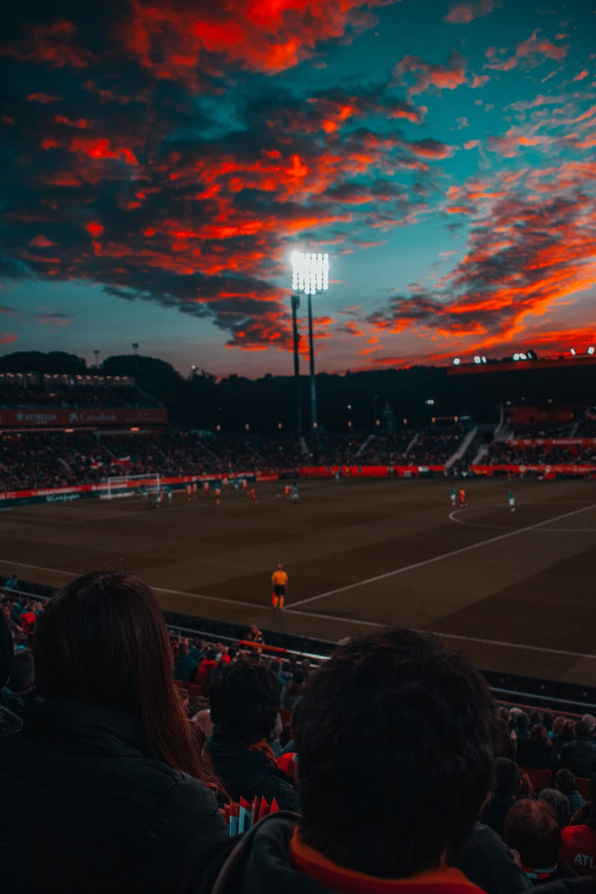 soccer field under red sky